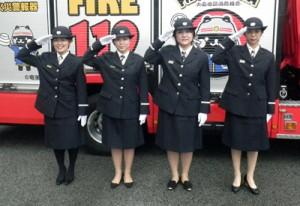 制服姿で決意を新たにする奄美市消防団特別分団女性小隊の団員=7日、奄美市名瀬