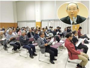 村田新八講演を聴講する住民。円内は塩満さん=2日、喜界町役場コミュニティーホール