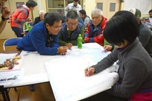 村北部の見どころを話し合う参加者=19日、宇検村久志