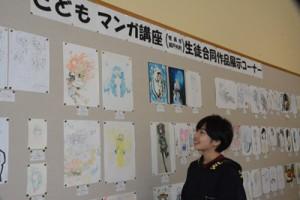114点の漫画やイラストを展示している合同作品展=27日、奄美市名瀬の県立奄美図書館