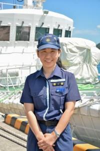 第10管区海上保安本部初の女性船長として着任した「いそなみ」の冨永船長=9日、奄美市の名瀬港