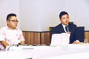 民泊の事業例について説明をする比嘉将貴さん(左)と古薗孝太さん(右)=28日、奄美市名瀬