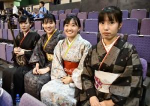 総合開会式で島唄を披露する(左から)岩﨑さん、政木さん、畠さん、且さん=8日、鹿児島市の鹿児島アリーナ
