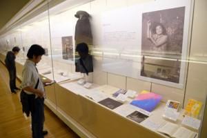 写真や日記、小説の草稿など多くの資料が並ぶ島尾ミホ展=18日、鹿児島市のかごしま近代文学館