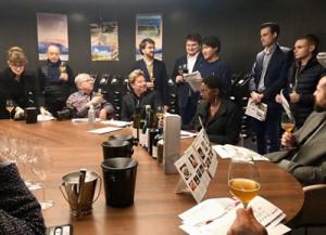 奄美の黒糖焼酎やクラフトビールの魅力などが紹介された焼酎セミナー=13日、フランス・パリ市のレストラン(提供写真)