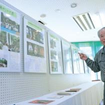 企画展の展示内容を紹介する和泊町歴史民俗資料館の先田さん=14日、同館