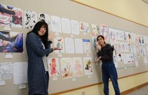 受講生らの力作が並ぶマンガ講座作品展=14日、奄美市名瀬の県立奄美図書館